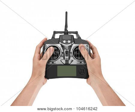 Radio remote control in hand, isolated on white background