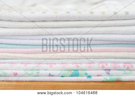 Stack Of Baby Clothes - Studio Shot