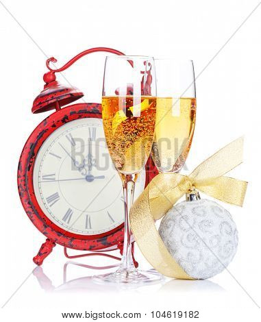 Two champagne glasses, christmas decor and clock. Isolated on white background