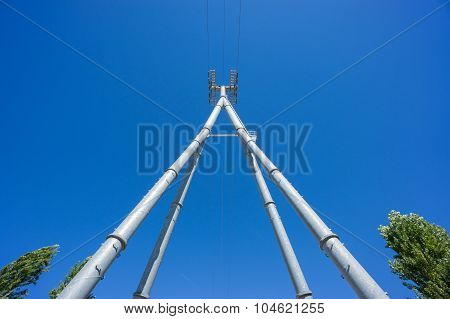 Wide Railway catenary against a blue sky
