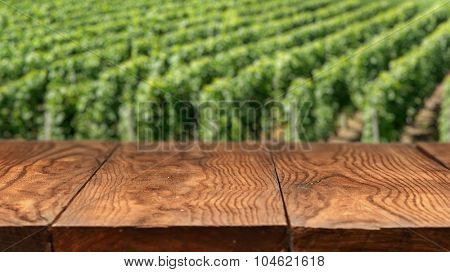 Empty wooden table with vineyard landscape in France on background. Header for website