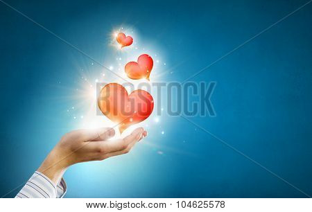 Close up of hands holding red heart