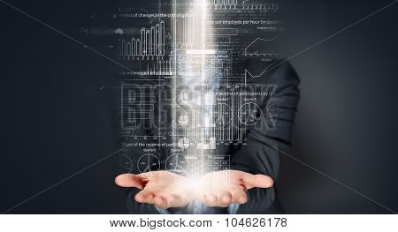 Close up of businesswoman holding market infographs in hands