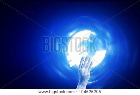 Close up of human hand holding euro symbol on blue background