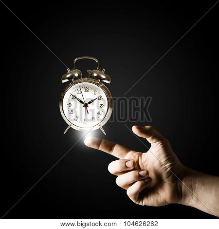 Close up of man hand pointing at clock watch