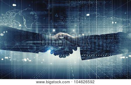 Close up of business handshake on digital background