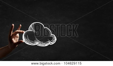 Human hand and drawn cloud in palm