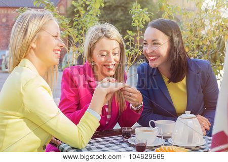 Woman showing  friends her ring