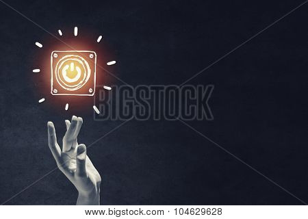 Power button hand drawn with chalk on blackboard background