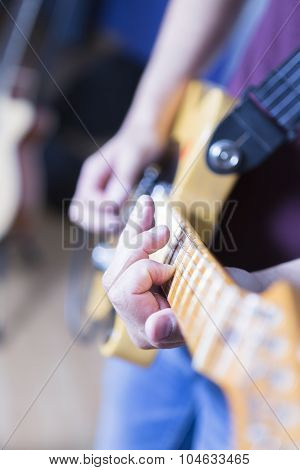 Playing An Electric Guitar