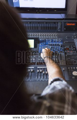 Sound Engineer Adjusting A Sound Mixing Desk