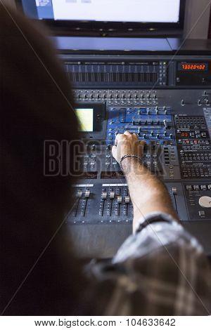 Sound Engineer Adjusting A Sound Mixing Desk