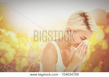 Sick woman blowing her nose against autumn scene
