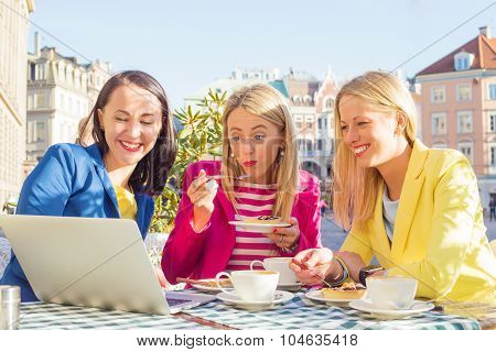 Three friends looking at computer