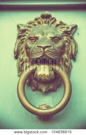 doorknocker like lion head , tero style toned photo