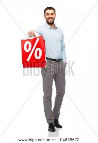 people, sale, discount and holidays concept - smiling man holding red shopping bags with percentage sign