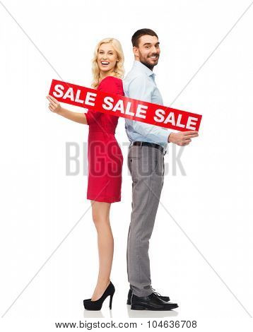 people, sale, discount and holidays concept - happy couple with red sale sign standing back to back