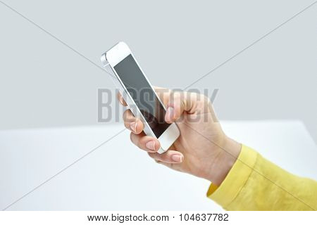 people, technology and internet concept - close up of teenage girl hand with smartphone at home