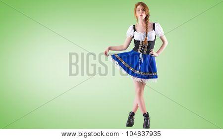 Oktoberfest girl spreading her skirt against green vignette