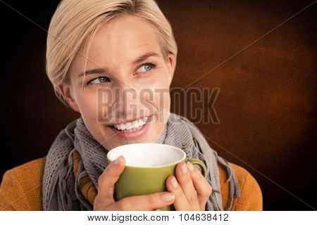 Close up of woman drinking from a cup against orange background with vignette