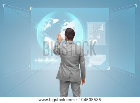 business, people and technology concept - businessman touching virtual screen with globe from back over blue background