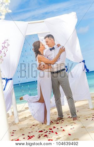 bride and groom on their wedding day on natural tropical beach background