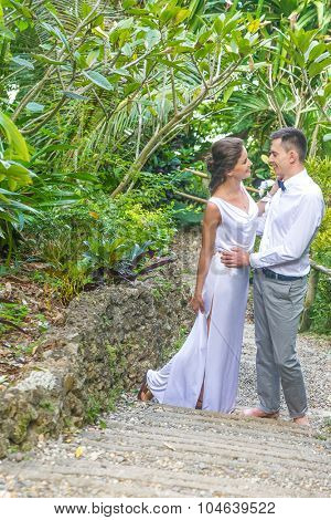 bride and groom on their wedding day on natural tropical forest background