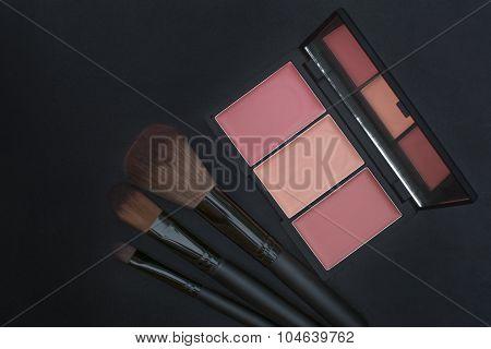 orange tone creamy blusher and makeup brushes
