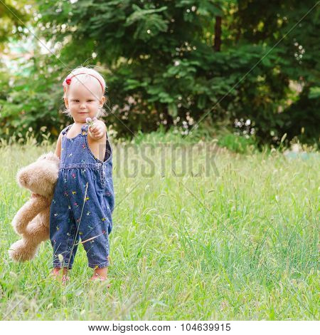 Little child with a teddy bear in his hands