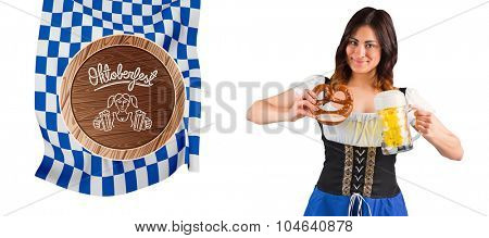 Pretty oktoberfest girl holding beer tankard and pretzel against oktoberfest graphics