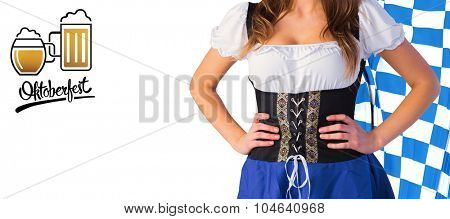 Oktoberfest girl standing with hands on hips against oktoberfest graphics