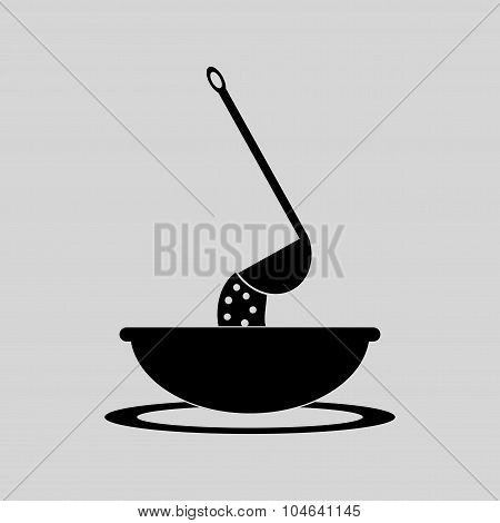 Flat in black and white bowl of soup