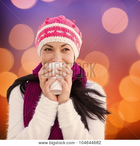 Winter brunette with coffee against glowing background