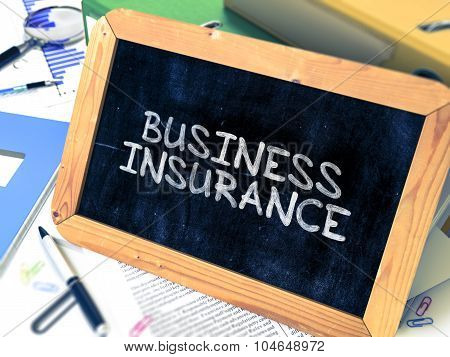 Business Insurance Handwritten on Chalkboard.
