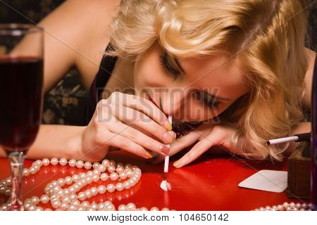 Sensual Blonde Lady In Black Sniffing Cocaine (imitation)