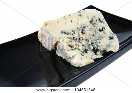 french stilton soft cheese on black plate