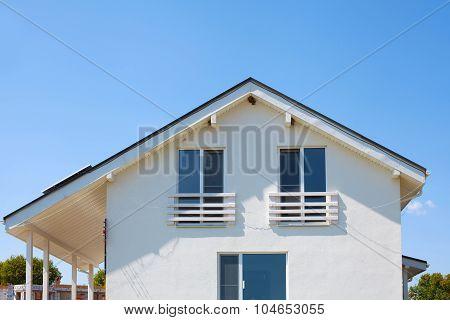 Facade of a new white frame house