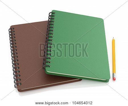 Brown And Green Notebook With Pencil On White Background.