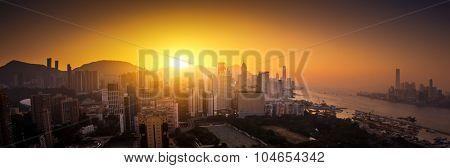 Panoramic view of Hong Kong skyline at sunset