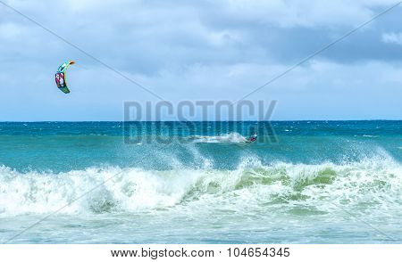 Extreme sports background. Kiteboarding at windy day in ocean
