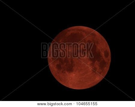 blood full moon on black sky background