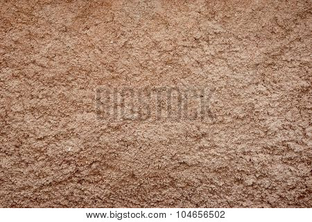 Decorative Brown Colored Grained Cement Plaster Wall Horizontal Background Closeup