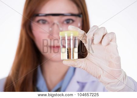 Doctor's Hand Holding A Bottle Of Urine Sample