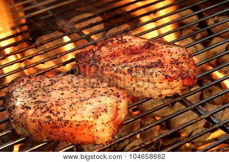Pork Loin Pepper Steaks On The Hot Bbq Flaming Grill