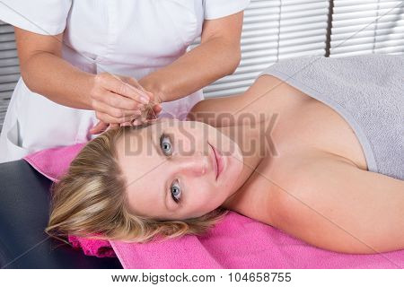 Acupuncture Treatment On Young Attractive Female Patient