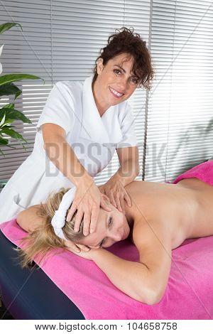 Alternative Medicine Therapist Using Crystal To Make A Massage