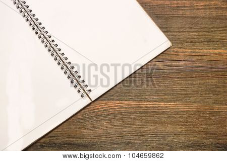 Notebook With Blank White Page  On The Rustic Wood Table