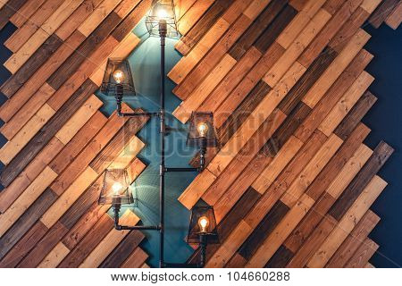 Modern Restaurant With Rustic Decorative Elements. Interior Design Details With Lamps And Bulb Light
