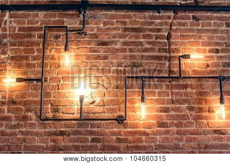 Interior Design Of Vintage Wall. Rustic Design, Brick Wall With Light Bulbs And Pipes, Low Lit Bar I
