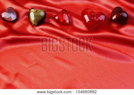 Glass love hearts on silk